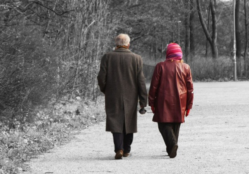 old couple walking away