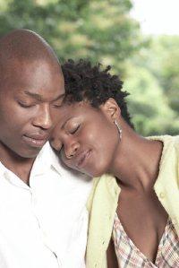 Woman-resting-her-head-on-man-s-shoulder-uid-1283701
