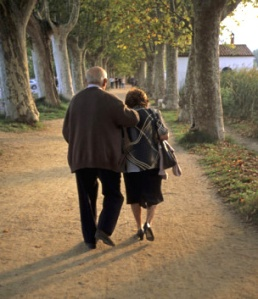 tino-soriano-an-elderly-couple-walking-along-a-tree-lined-dirt-roadEDIT2