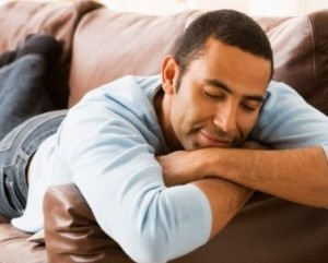 black-man-sleeping-on-couch-378x304