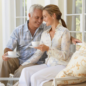 older-man-younger-woman-on-patio-square