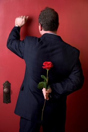 man-with-rose-at-door