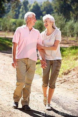 senior-couple-walking-country-21235370